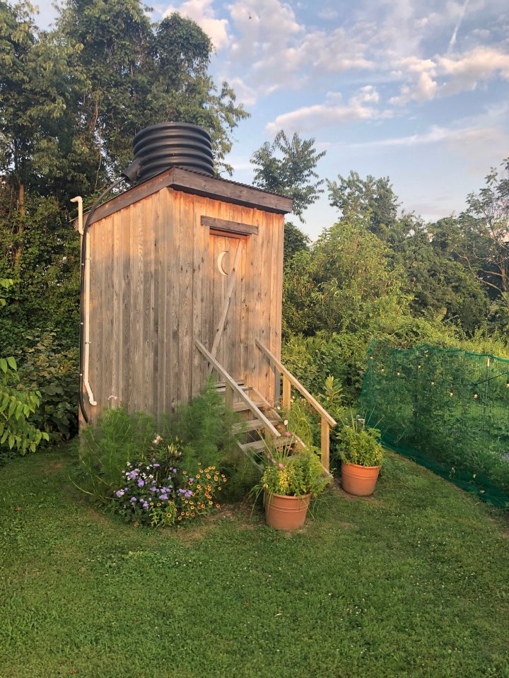 I just have to end with this: Is this not the prettiest outhouse you've ever seen? It was adorable on the inside as well, clean and odor-free thanks to the amazing magic of the composting toilet.