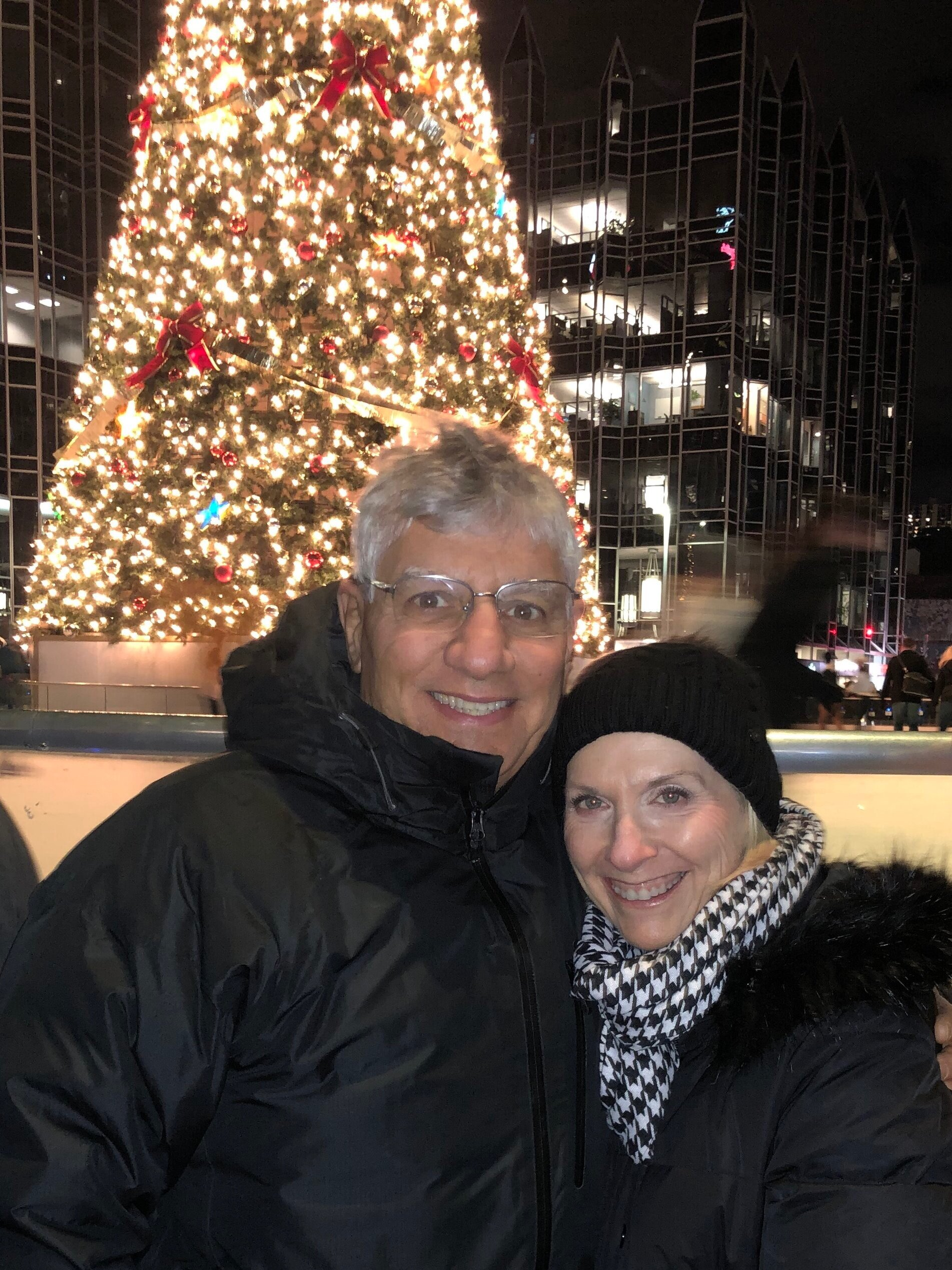 In front of the tree and ice rink at PPG Place on Light Up Night